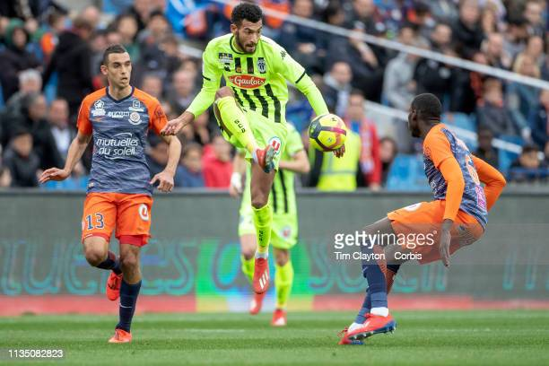Angelo Fulgini of Angers defended by Salomon Sambia of Montpellier and Ellyes Skhiri of Montpellier during the Montpellier V Angers French Ligue 1...