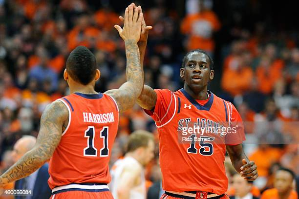 Angelo Harrison and Sir'Dominic Pointer of the St John's Red Storm react to a play against the Syracuse Orange during the first half at the Carrier...