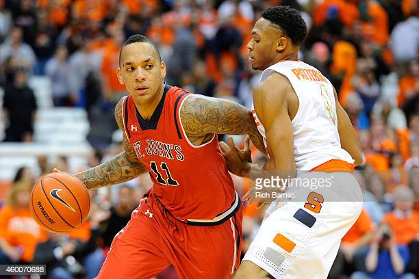 Angelo Harrison of the St John's Red Storm drives to the basket past Ron Patterson of the Syracuse Orange during the second half of the game at the...