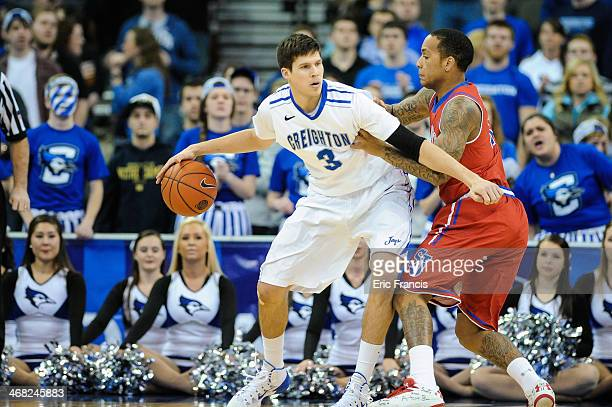 Angelo Harrison of the St John's Red Storm guards Doug McDermott of the Creighton Bluejays during their game at CenturyLink Center on January 28 2014...