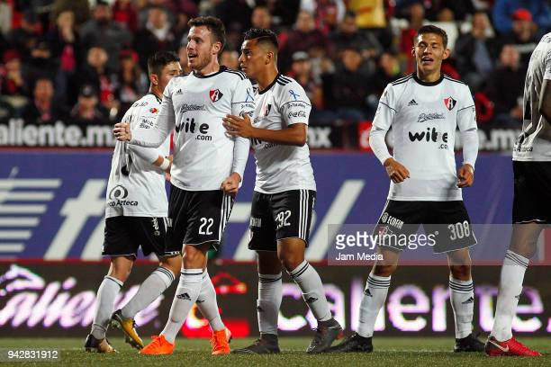 Angelo Henriquez of Atlas celebrates after scoring the first goal of his team during the 14th round match between Tijuana and Atlas as part of the...