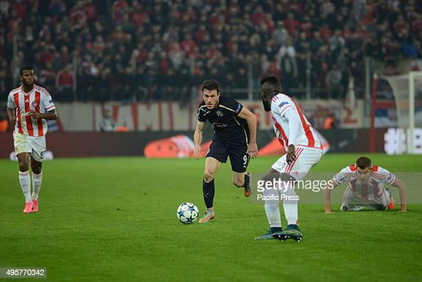 Angelo Henriquez of Dinamo Zagreb tries to avoid players of Olympiacos
