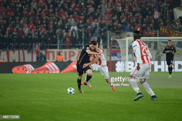 Angelo Henriquez of Dinamo Zagreb tries to pass from Alferd Finnbogason of Olympiacos