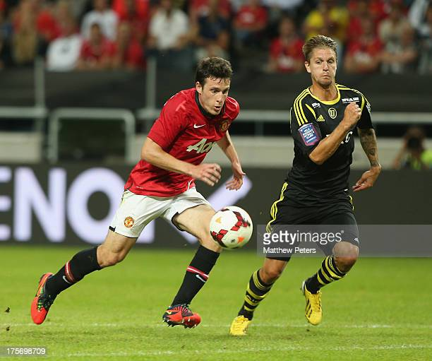 Angelo Henriquez of Manchester United in action with Per Karlsson of AIK Fotboll during the preseason friendly match between AIK Fotboll and...