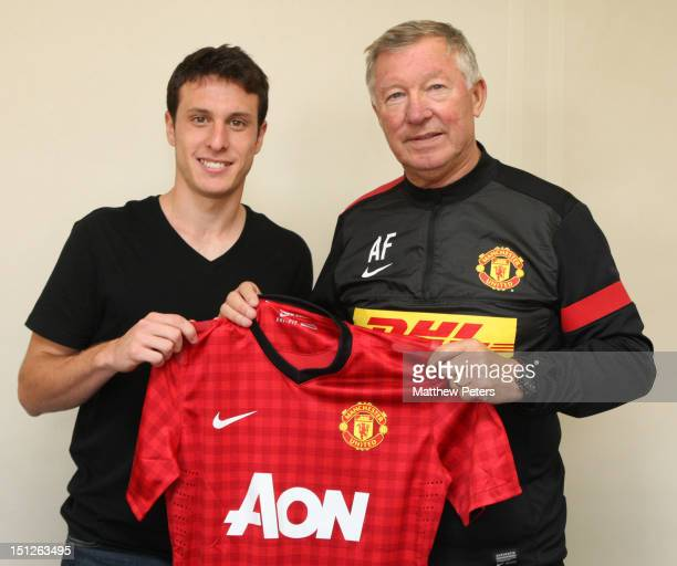 Angelo Henriquez of Manchester United poses with Manager Sir Alex Ferguson after signing for the club on August 31, 2012 at Carrington Training...