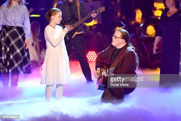 Angelo Kelly and his daughter Emma Kelly perform during the show 'Schlagercountdown Das grosse Premierenfest' at EWE Arena on March 25 2017 in...