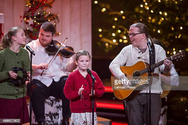 Angelo Kelly and his family perform during the 'Heiligabend mit Carmen Nebel' TV show at Bavaria Filmstudios on November 26 2015 in Munich Germany