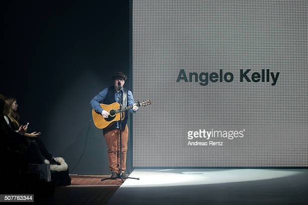 Angelo Kelly performs on the runway at the Beate Heymann Meerstein show during Platform Fashion January 2016 at Areal Boehler on January 31 2016 in...