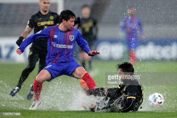 Angelo Marasigan of Ceres-Negros in action against Shuto Abe of FC Tokyo during the AFC Champions League play off between FC Tokyo and Ceres-Negros...