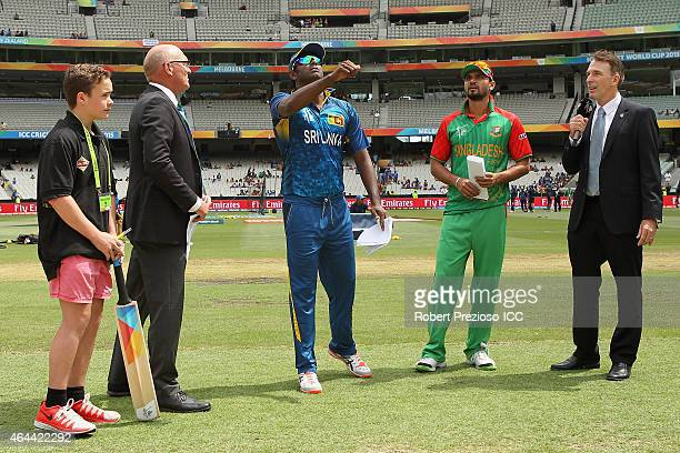 Angelo Mathews of Sri Lanka and Mashrafe Mortaza of Bangladesh toss the coin during the 2015 ICC Cricket World Cup match between Sri Lanka and...