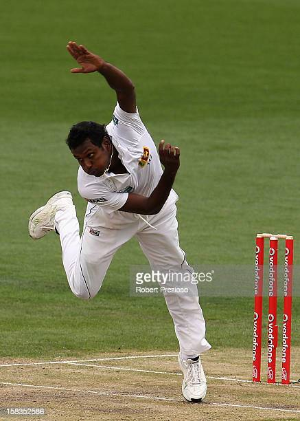 Angelo Mathews of Sri Lanka bowls during day one of the First Test match between Australia and Sri Lanka at Blundstone Arena on December 14 2012 in...