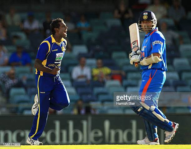 Angelo Mathews of Sri Lanka celebrate after taking the wicket of Sachin Tendulkar of India during the One Day International match between India and...