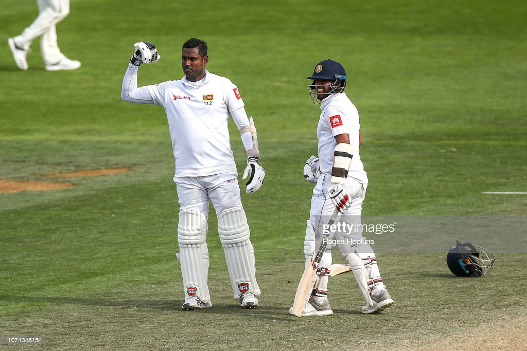 15291a83 Angelo Mathews of Sri Lanka celebrates his century with Kusal Mendis ...