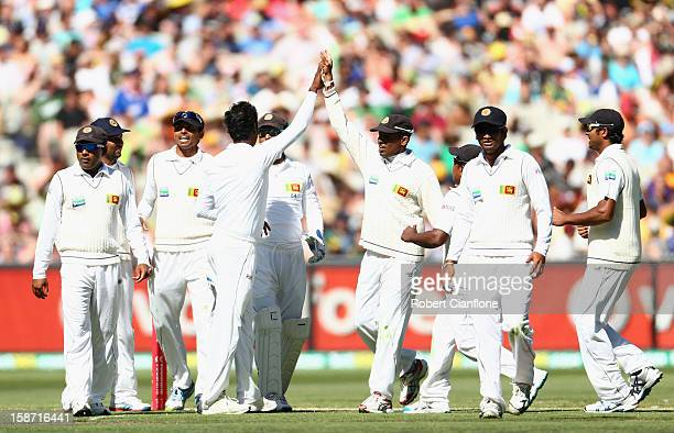 Angelo Mathews of Sri Lanka celebrates the wicket of David Warner of Australia during day one of the Second Test match between Australia and Sri...