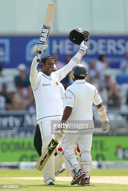 Angelo Mathews of Sri Lanka celebrates with Rangana Herath of Sri Lanka after reaching 100 during day four of the 2nd Investec Test match between...