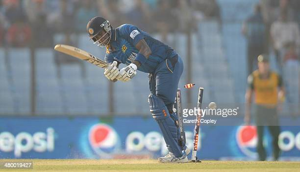 Angelo Mathews of Sri Lanka is bowled by Dale Steyn of South Africa during the ICC World Twenty20 Bangladesh 2014 Group 1 match between Sri Lanka and...