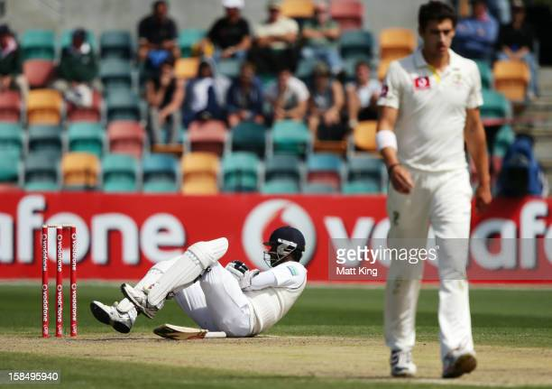 Angelo Mathews of Sri Lanka lies down after being hit by a ball from Mitchell Starc of Australia during day five of the First Test match between...
