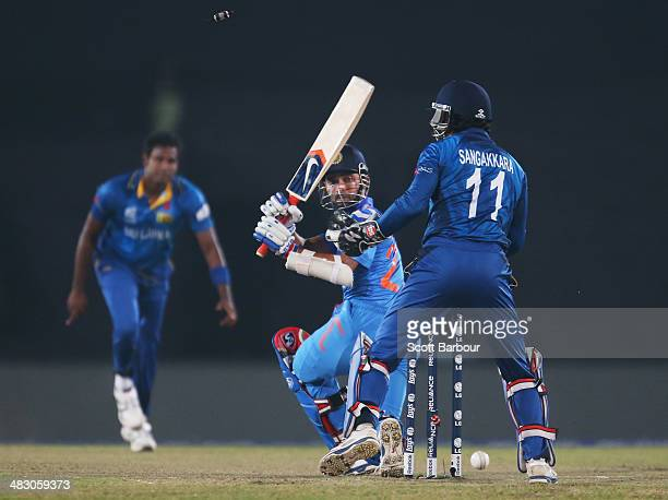 Angelo Mathews of Sri Lanka looks on as he bowls Ajinkya Rahane of India during the Final of the ICC World Twenty20 Bangladesh 2014 between India and...