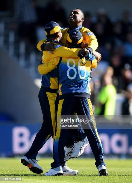 Angelo Matthews of Sri Lanka celebrates with his team after the wicket of Mark Wood of England which won them the match after the Group Stage match...