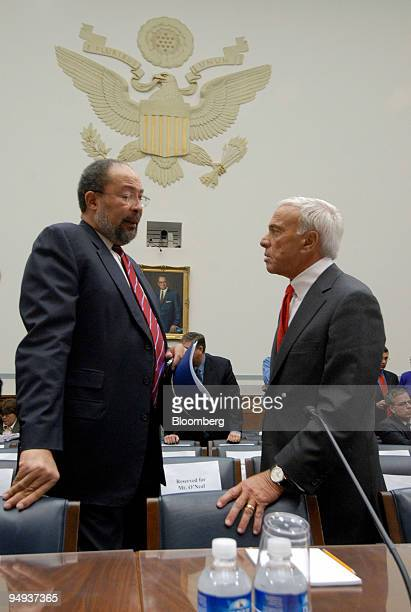 Angelo Mozilo chief executive officer of Countrywide Financial Corp right speaks with Richard Parsons chairman of Time Warner Inc before a hearing of...