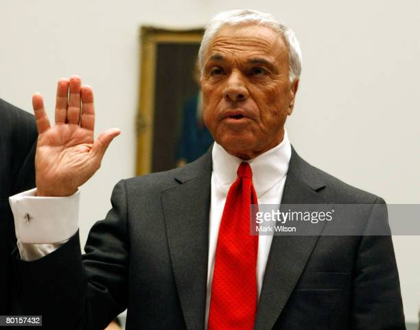 Angelo Mozilo founder and former CEO Countrywide Financial Corporation raises his right hand as he is sworn in during a House Oversight and...
