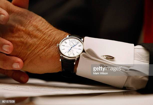 Angelo Mozilo founder and former CEO Countrywide Financial Corporation waers a watch while testifying during a House Oversight and Government Reform...