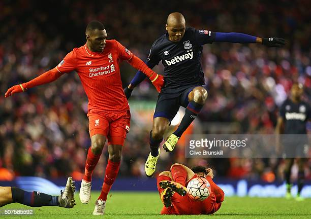 Angelo Ogbonna Obinza of West Ham United battles with Christian Benteke and Joao Carlos Teixeira of Liverpool during the Emirates FA Cup Fourth Round...