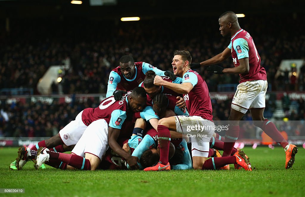 Angelo Ogbonna Obinza of West Ham United is mobbed in celebration by team mates as he scores their second goal during the Emirates FA Cup Fourth Round Replay match between West Ham United and Liverpool at Boleyn Ground on February 9, 2016 in London, England.