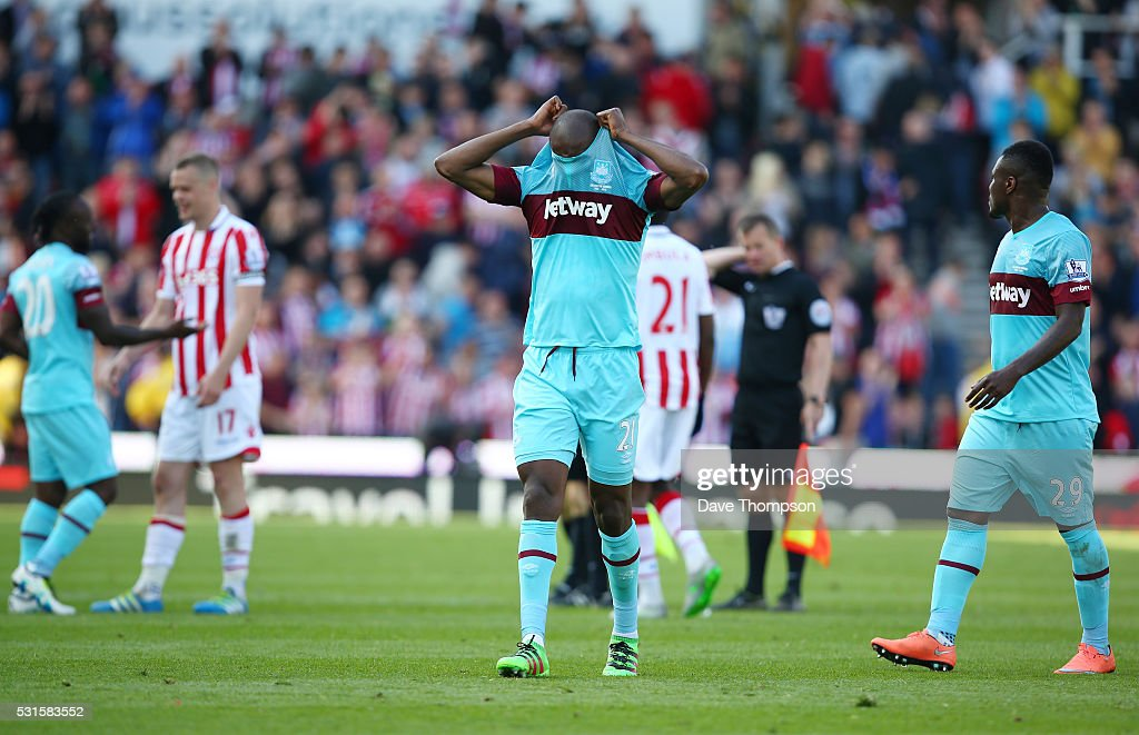 Angelo Ogbonna Obinza of West Ham United reacts after his team's 1-2 defeat in the Barclays Premier League match between Stoke City and West Ham United at the Britannia Stadium on May 15, 2016 in Stoke on Trent, England.