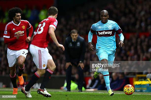 Angelo Ogbonna Obinza of West Ham United takes on Paddy McNair and Marouane Fellaini of Manchester United during the Barclays Premier League match...