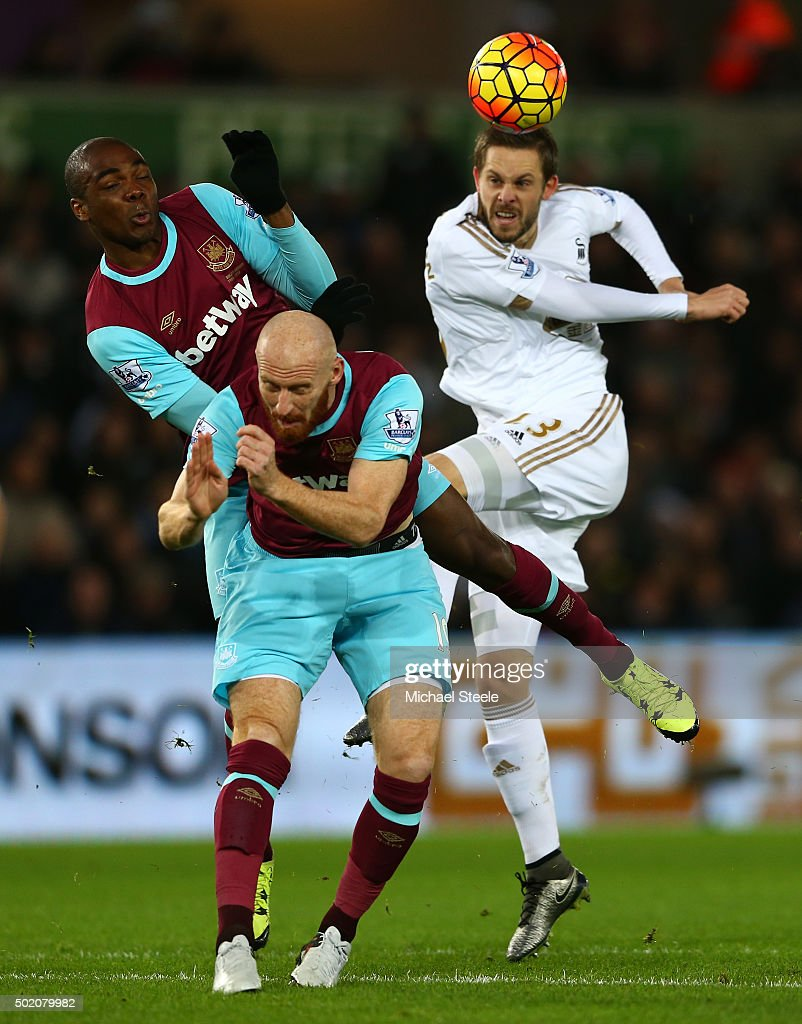 Angelo Ogbonna Obinze and James Collins of West Ham battle for the ball against Gylfi Sigurdsson of Swansea City during the Barclays Premier League match between Swansea City and West Ham United at the Liberty Stadium on December 20, 2015 in Swansea, Wales.