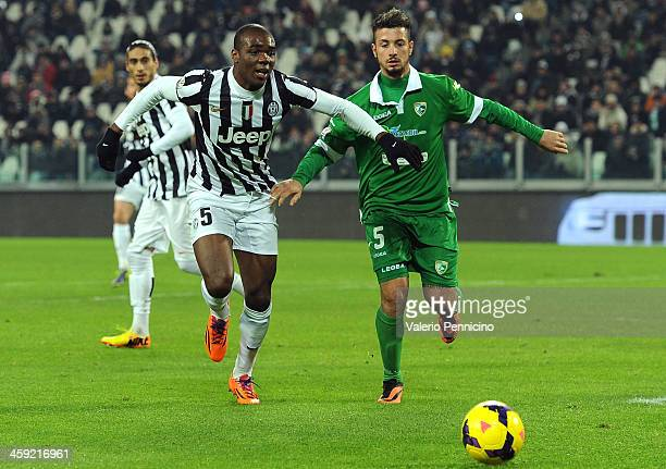 Angelo Ogbonna of Juventus competes with Armando Izzo of US Avellino during the Tim Cup match between Juventus and US Avellino at Juventus Arena on...