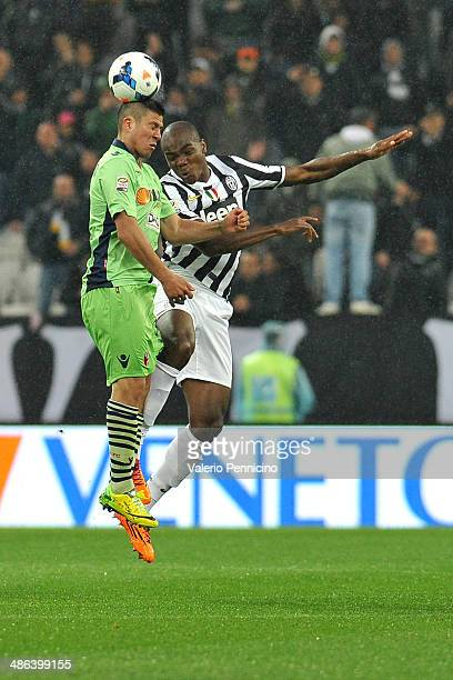 Angelo Ogbonna of Juventus goes up with Jonathan Cristaldo of Bologna FC during the Serie A match between Juventus and Bologna FC at Juventus Arena...