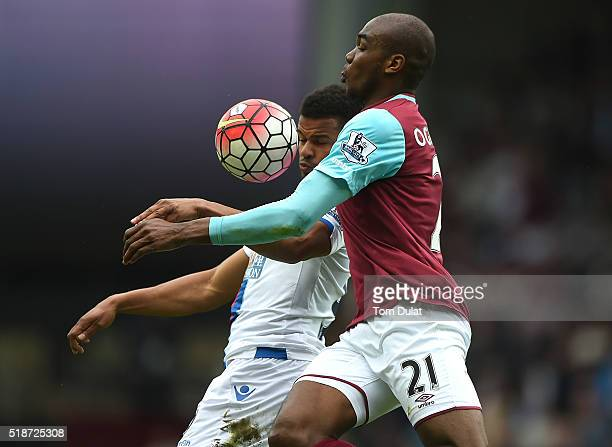 Angelo Ogbonna of West Ham United and Fraizer Campbell of Crystal Palace in action during the Barclays Premier League match between West Ham United...