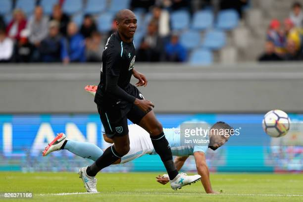 Angelo Ogbonna of West Ham United and Sergio Aguero of Manchester City battle for possession during a Pre Season Friendly between Manchester City and...