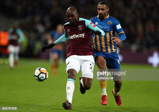 Angelo Ogbonna of West Ham United and Stefan Payne of Shrewsbury Town during the Emirates FA Cup Third Round Replay match between West Ham United and...