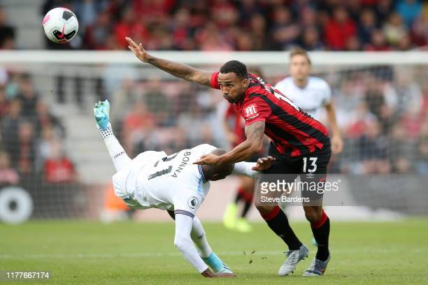 Angelo Ogbonna of West Ham United battles for possession with Callum Wilson of AFC Bournemouth during the Premier League match between AFC...