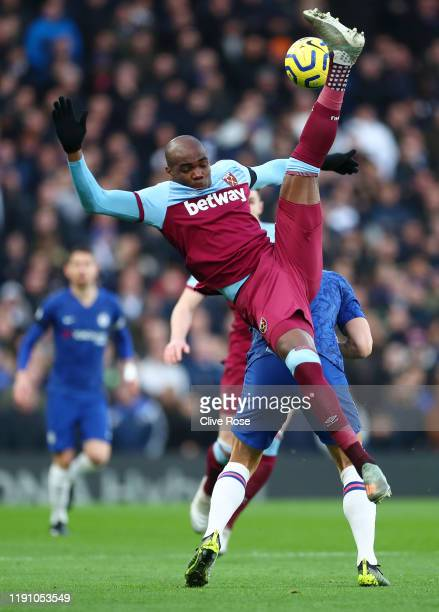 Angelo Ogbonna of West Ham United battles for possession with Olivier Giroud of Chelsea during the Premier League match between Chelsea FC and West...