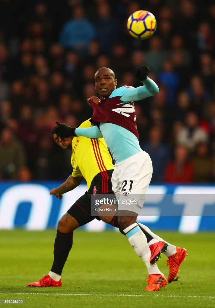 Angelo Ogbonna of West Ham United battles with Andre Gray of Watford during the Premier League match between Watford and West Ham United at Vicarage Road on November 19, 2017 in Watford, England.
