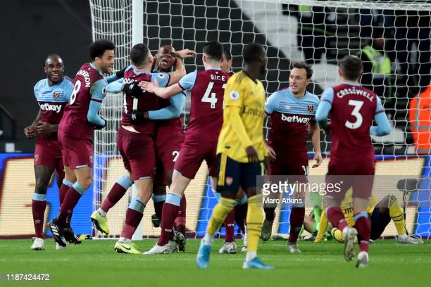 Angelo Ogbonna of West Ham United celebrates scoring the opening goal among team mates during the Premier League match between West Ham United and...