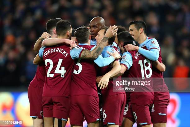 Angelo Ogbonna of West Ham United celebrates with Robert Snodgrass and team mates after he scores his sides first goal during the Premier League...