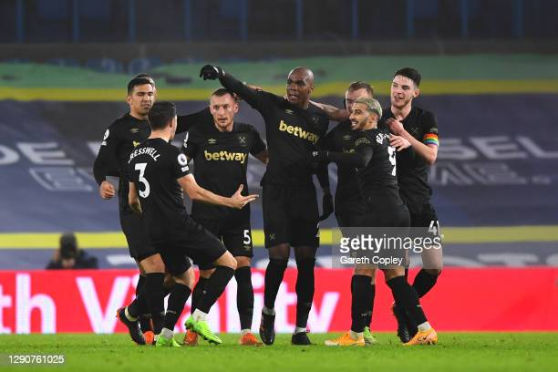 Angelo Ogbonna of West Ham United celebrates with team mates Aaron Cresswell, Vladimir Coufal, Said Benrahma and Declan Rice after scoring their...