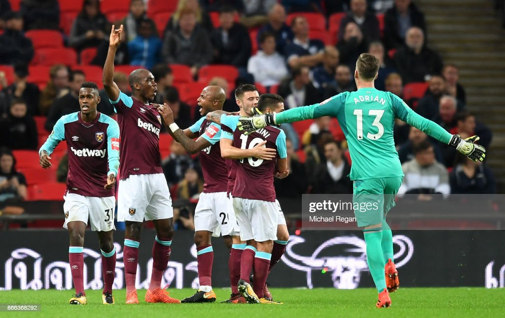 Angelo Ogbonna of West Ham United celebrates with team mates after scoring his side's third goal during the Carabao Cup Fourth Round match between Tottenham Hotspur and West Ham United at Wembley Stadium on October 25, 2017 in London, England.