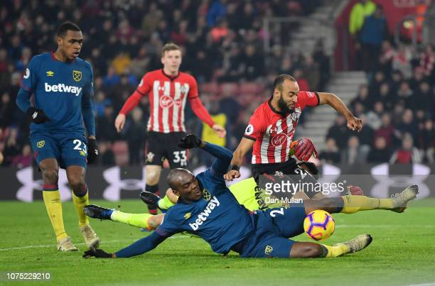 Angelo Ogbonna of West Ham United collides with Nathan Redmond of Southampton prior to Nathan Redmond of Southampton scoring his sides first goal...