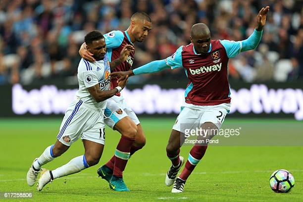 Angelo Ogbonna of West Ham United controls the ball while Jermain Defoe of Sunderland and Winston Reid of West Ham United battle for possession...