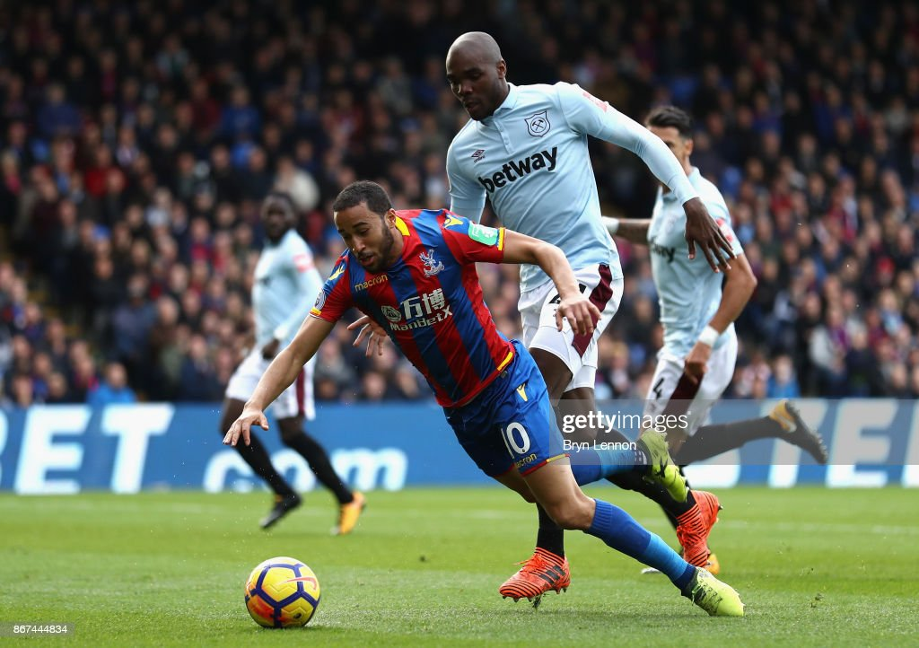 Angelo Ogbonna of West Ham United fouls Andros Townsend of Crystal Palace and a penalty is later awarded during the Premier League match between Crystal Palace and West Ham United at Selhurst Park on October 28, 2017 in London, England.