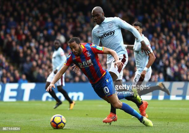 Angelo Ogbonna of West Ham United fouls Andros Townsend of Crystal Palace and a penalty is later awarded during the Premier League match between...