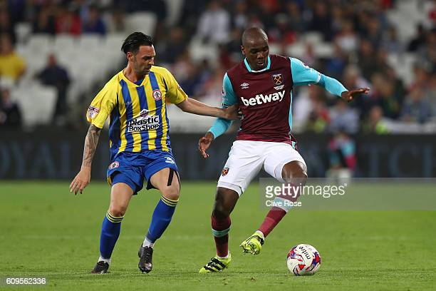 Angelo Ogbonna of West Ham United holds off Chris Eagles of Accrington Stanley during the EFL Cup Third Round match between West Ham United and...