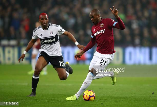 Angelo Ogbonna of West Ham United holds off Ryan Babel of Fulham during the Premier League match between West Ham United and Fulham FC at the London...