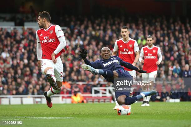 Angelo Ogbonna of West Ham United kicks the ball in the air during the Premier League match between Arsenal FC and West Ham United at Emirates...